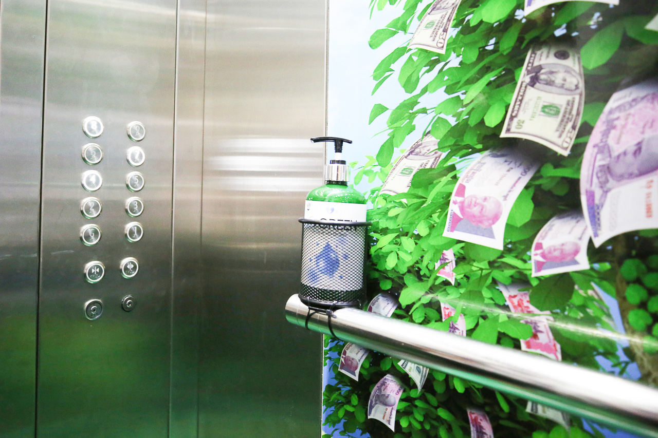 Alcohol-based hand sanitizer gel is equipped in the elevators and entrance/exit doors.